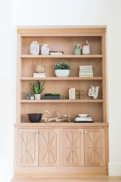pale wood built in hutch with x motif on doors, open shelves above
