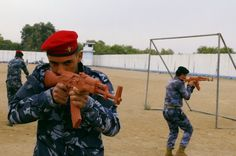 Sunni tribesmen take part in military training, as they prepare to fight against militants of the Islamic State, on the outskirt of Ramadi, west of Baghdad, November 16, 2014. Islamic State's systematic massacre of hundreds of Iraq's Albu Nimr tribe should have been an unmistakable wake up call for a country that may not be able to stabilise without long-term support from Sunni tribesmen.