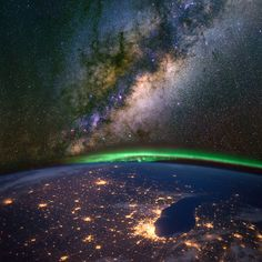 Chicago and lake Michigan from space at night, with the aurora Borealis and the Milky Way. Elements of this image furnished by NASA. ©MarcelClemens / Shutterstock