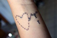 Needle and Thread Heart Tattoo
