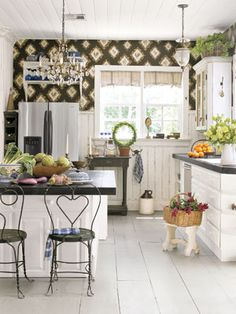 Work Off of One Idea  In this kitchen, design is based around the graphic rooster wallpaper.