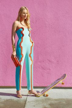 love this jumpsuit. and love the pink backdrop.