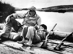 Robert Capa: American writer Ernest Hemingway with his son Gregory. Sun Valley, Idaho. October, 1941.