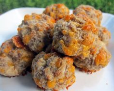 Cream Cheese Sausage Balls  1 lb hot sausage, uncooked  8 oz cream cheese, softened  1 1/4 cups Bisquick  4 oz cheddar cheese, shredded    Preheat oven to 400F.    Mix all ingredients until well combined. (I use my KitchenAid mixer with the dough hook attachment)  Roll into 1-inch balls.  Bake for 20-25 minutes, or until brown.    Sausage balls may be frozen uncooked.  If baking frozen, add a few minutes to the baking time