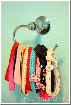 HEADBAND and/or HAIR RIBBON HOLDER...IT'S A HAND TOWEL RACK