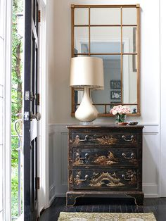 This vignette packs a lot of punch in just a sliver of space, as pieces with Oriental flavor gather just inside the front door: http://www.bhg.com/rooms/rooms/entryway/front-entry-decor-ideas/?socsrc=bhgpin031914asianinfluence&page=2