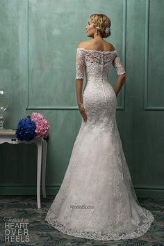 I am SO in LOVE with so many of these dresses! Amelia Sposa 2014 Wedding Dresses Heart Over Heels