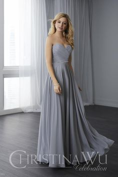 ed3efa8ed43 This chiffon bodice features intricate draping and a sweetheart neckline. A  thin beaded belt is