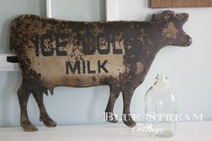 No farmhouse is complete without a little farm animal decor.  This metal cow wall art is the perfect accessory to dress up your farmhouse! CONDITION: No two signs are exactly the same, each h...