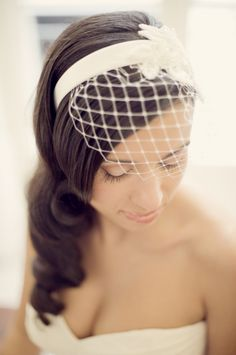 The bride made her own veil! Photo by Piteira Photography