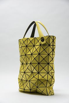 6f4ded6f98586 This high-tech rainbow hue tote by Issey Miyake a part of his iconic ...