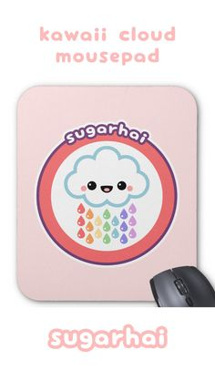 Super cute pink mousepad featuring a smiling cloud raining rainbow raindrops.