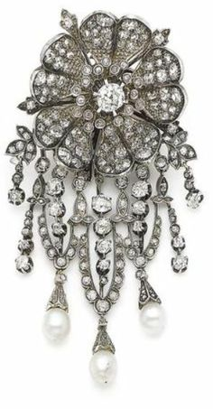 A late 19th century natural pearl and diamond flower brooch.