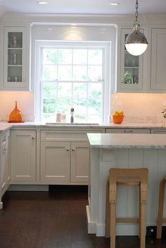 Cynthia Brooks Design -- white kitchen, shaker style cabinets, subway tile, dark hardwood floors, nice lighting