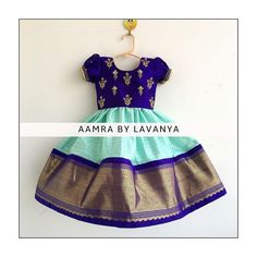 Stunning sea green and blue color combination kids pattu lehenga and blue color top. Kids parikini with floral design hand embroidery gold thread work. For details and color customisations please call/whatsapp on 11 February 2019 Kids Party Wear Dresses, Kids Dress Wear, Dresses Kids Girl, Kids Outfits, Baby Dresses, Kids Wear, Kids Indian Wear, Kids Ethnic Wear, Kids Frocks Design