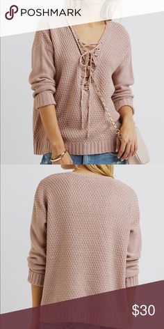 "Lace-Up Pullover Sweater - pale mauve Keep yourself comfy and cute in this versatile sweater! The chunky, lightweight knit and flowy hem keep it casual, while the lace-up V-neck adds an edgy twist!  Product Fit:Model is wearing size small. Size small measures 24"" from top to hem. Product Care:acrylic / machine wash / imported Sweaters V-Necks"