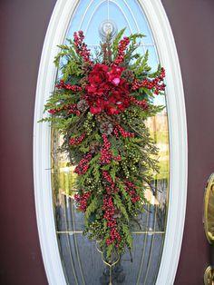 "Christmas Wreath Winter Wreath Holiday Vertical Teardrop Swag Door Decor..""Seasons Greetings"". $80.00, via Etsy."
