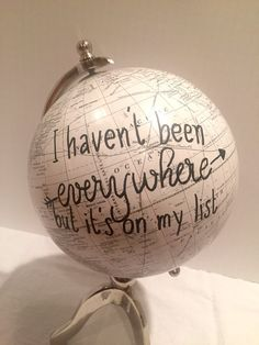 Medium sized white globe on unique stand with hand painted phrase: I havent been everywhere but its on my list. Please message shop with questions