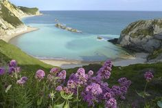 This beach is called Man of War Bay… and it's in Isle Of Purbeck, Dorset.