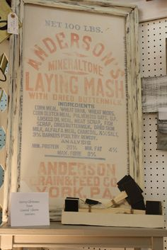 A feed sack framed....I know just where to get these and will need to go back to my favorite Berlin Antique Mall.