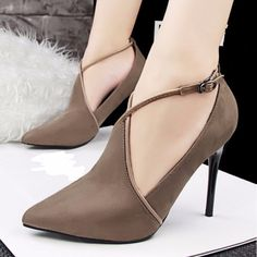 Look good without so much effort with this elegant stilettto. It features a suede upper, glossy cross tied strap, asymmetric design, pointed toe and thin high heels. This stiletto is made of rubber, n