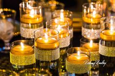 Glittering gold candles. Photography by Rodney Bailey.