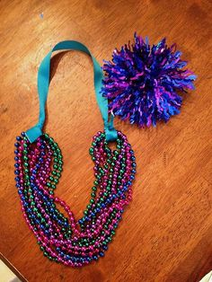 diy statement necklace for kids made with recycled mardi gras beads