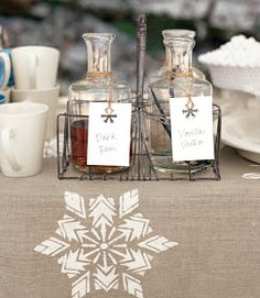 "Hand stenciled snow flake on the table runner.  ""Spirits"" for the adult hot chocolate."