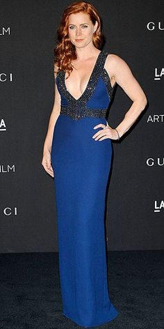 """We're starting to think LACMA also stands for """"Ladies and Cleavage Make Art,"""" because so many stars put their décolletage on display at the event. Amy follows suit in a low-cut navy Gucci look and her signature old-Hollywood waves."""