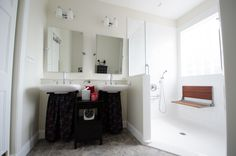 Bathroom Remodel - Walk in shower - with no threshold - handicap accessible shower - white tiled shower, shower seat, multiple shower heads, window in the shower, Universal Design - dual  sinks and mirrors  - brought to you by Re-Bath of the Triangle