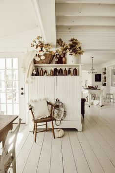 I could do this on top of by TV cabinet. Basket w/ old wool blanket, amber bottles, old clocks, crock with branches. Bamboo Laminate Flooring, Plank Flooring, Vinyl Flooring, The Found Cottage, Rustic Apartment, Apartment Interior, Amber Bottles, Vintage Chandelier, Do It Yourself Home