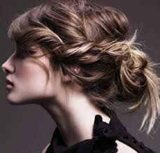 Romantic twists and loose sprayed hair at the back