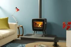 Nice and cosy on the couch, with the stove on. Vintage style. ©Dovre