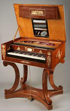 A unique Austrian Bidermeier gilt bronze mounted mahogany, fruitwood and ebonised table piano signed Sebastain Kober. The hinged top mounted...