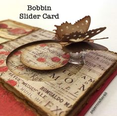 Here's an alternative to using pennies for your next slider card … use a plastic bobbin instead! The lightweight, clear bobbin allows your focal embellishment to move around freely & easily! YouTube tutorial by papercrafter45.