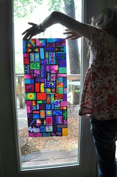 Sharpie markers on wax paper = stained glass!