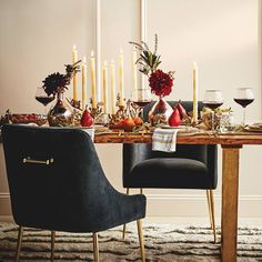 Getting the table Christmas ready with candles and wine glasses galore!