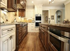 Stained & painted cabinets!  Looks great! #microwavedrawer #cabinets #walkerwoodworking