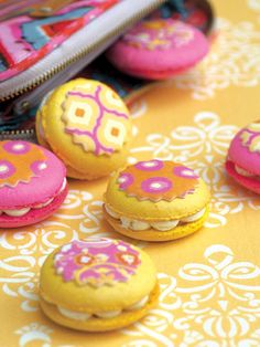 Exotic Girl Macarons created with Lucks Designer Prints applied to fondant disks. Dena Designs patterns used.