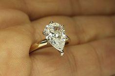 3-00-PEAR-SHAPE-DIAMOND-ENGAGEMENT-RING-14-KARAT-Yellow-Gold