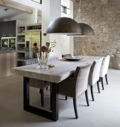 I like the kitchen with this dining place. Open spaces.