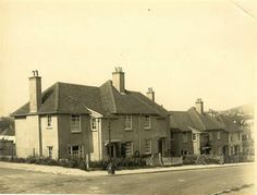 Photo:Council Houses in Moulsecoomb, 1920s: A row of semi-detached and detached houses in Moulsecoomb. South Moulsecoomb was the first large-scale estate in Brighton, built from 1920 to 1924 with large gardens and large open spaces. North Moulsecoomb was built from 1926-30 but with less surrounding space. East Moulsecoomb followed in 1935-36.