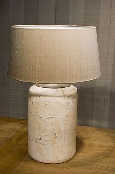 Olive oil drum lamp with silk shade, as featured in the Spring 2013 luxury interior scheme for dining rooms