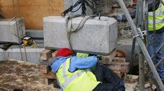 BOSTON –  Crews removed a time capsule dating back to 1795 on Thursday from the granite cornerstone of the Massachusetts Statehouse, where historians believe it was originally placed by Revolutionary War luminaries Samuel Adams and Paul Revere among others.