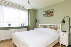 Rustgevende kleuren in de slaapkamer.
