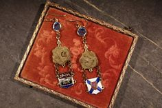 New Brunswick and Nova Scotia souvenir bracelet charms are the focal point of these lovely assemblage earrings. Such an interesting combination of an antique jewelry bits from an old souvenir bracelet, featuring charms from New Brunswick and Nova Scotia. The shield-like enameled drops (2