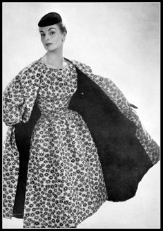 Model in white ottoman print dress with black flowers with accompanying coat, by Balenciaga, photo by Georges Saad, 1954, photo