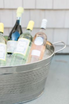 Wine and a cooler are essential! http://www.stylemepretty.com/living/2015/07/09/inspiration-for-a-new-england-lobster-boil-with-pier-1-imports/ | Photography: Ruth Eileen - http://rutheileenphotography.com/
