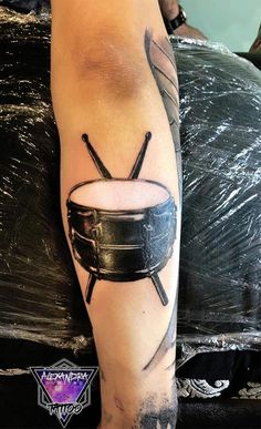 A snare drum and a pair of drumsticks tattoo. This is a music themed full sleeve in the making.