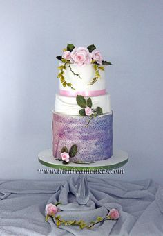 Worked on this simple 3 tier cake with Roses and Purple Texture. Love making gumpaste roses